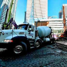 concrete trucks in middle of the city